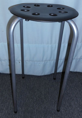 Silver metal and black plastic stool