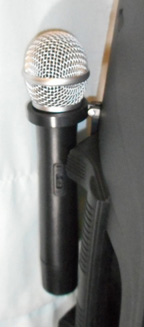 1 of 2 included wireless microphones included with rental